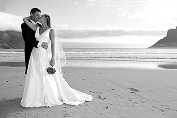 Wedding kiss on the beach just after the wedding ceremony