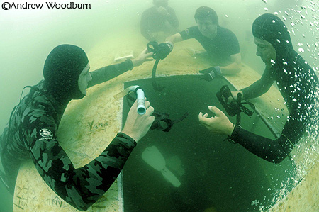 Freedivers doing mask swap training at 14m AW