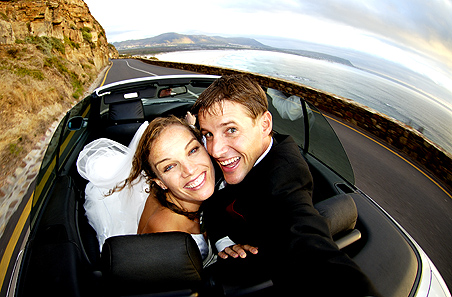 copyright Andrew Woodburn, wedding photography of the bridal couple  on Chapmans Peak drive, Capetown